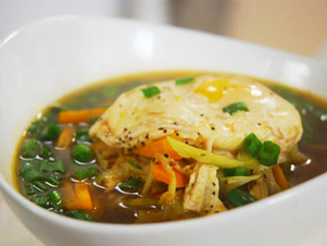 Chicken broth with poached egg