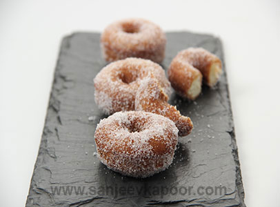 How to make eggless mawa elaichi doughnuts recipe by masterchef how to make eggless mawa elaichi doughnuts recipe by masterchef sanjeev kapoor forumfinder Image collections